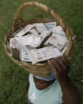 A Zimbabwean lady with a basketful of cash