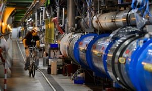 A worker rides on his bicycle in Cern's Large Hadron Collider (LHC) tunnel.