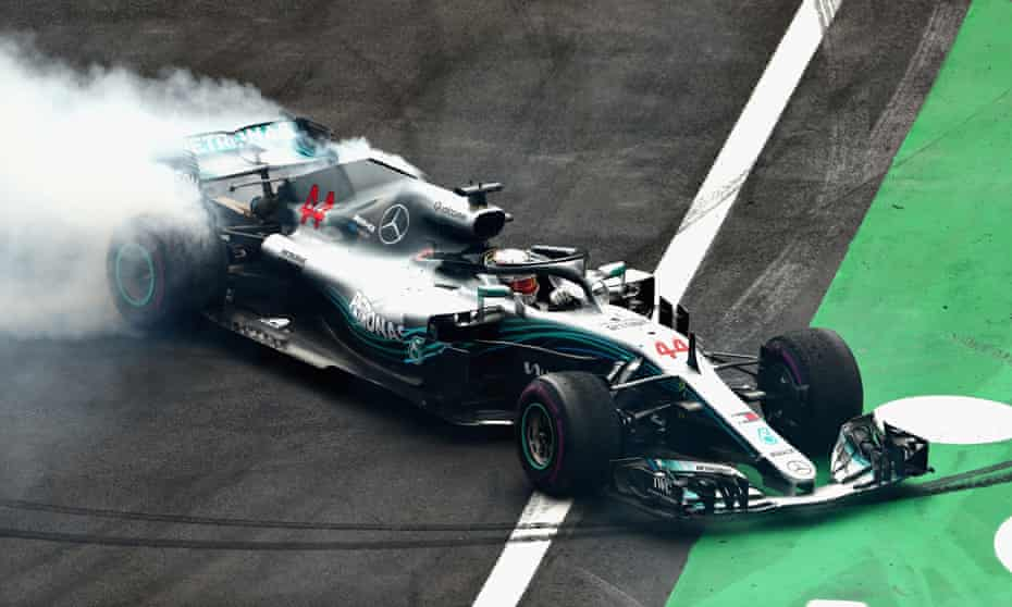 Lewis Hamilton celebrates securing his fifth Formula One world title, at the Mexico Grand Prix.