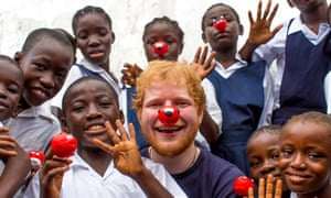 Ed Sheeran during a trip to Liberia for Comic Relief, which was criticised in 2014 after it was discovered to have invested in arms, tobacco and alcohol companies.