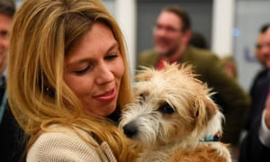 Carrie Symonds with Dilyn, the dog she shares with Boris Johnson, in December.