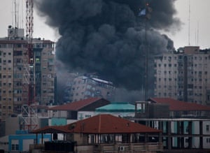 An apartment building collapses just after it was hit by missiles during an Israeli air strike on the heart of Gaza City