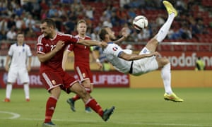Hungary, whose defender Roland Juhasz is here taking evasive action against Greece, were on course for automatic qualification until Turkey scored a late winner against Iceland.