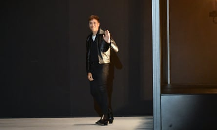 Hedi Slimane waving to the audience after the show.