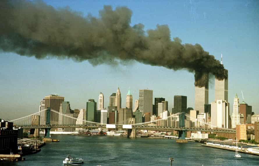 The towers of the World Trade Center pour smoke shortly after being struck by hijacked commercial airplanes in New York on September 11, 2001.