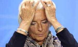 Christine Lagarde puts her head in her hands