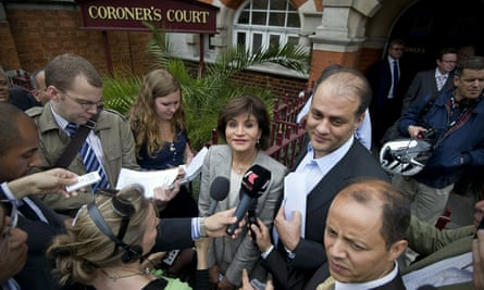 Mona Marwan (centre) and Ahmed Marwan (centre right), widow and son of Ashraf Marwan, leaving court in London after the 2010 inquest into his death returned no verdict.