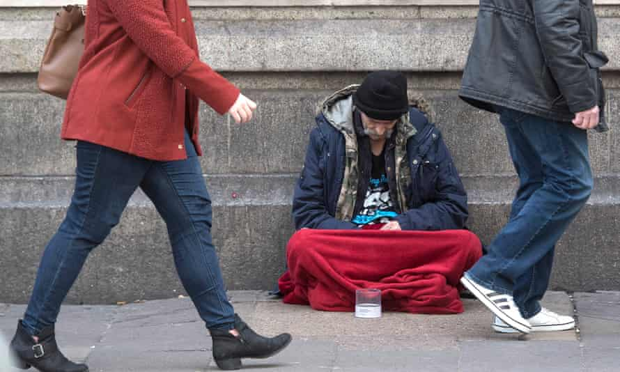 A homeless man outside Victoria Station in London.