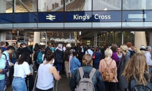 Hundreds of passengers wait at King's Cross station. London. Travellers told yesterday of their horror stories of being trapped on a train for up to 12 hours after Friday's power outage.