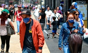 People wear face masks to combat air pollution in Mexico City