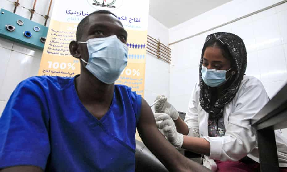 A medical worker receives a dose of coronavirus vaccine at a hospital in Khartoum, Sudan, on March 9, 2021.