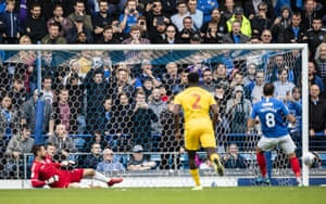 Bolton goalkeeper Remi Matthews looks on as Portsmouth's Brett Pitman hits the post with a penalty kick.