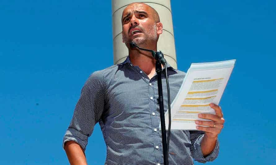 Pep Guardiola, picture at a rally in support of the Catalan independence referendum, admitted his trophy-free season at Manchester City would have got him sacked elsewhere.