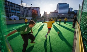 In Go Wide football, there is one giant goal in the middle of the pitch