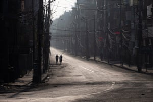 Kathmandu, Nepal People walk along an empty road during an emergency nationwide week-long lockdown to combat Covid-19