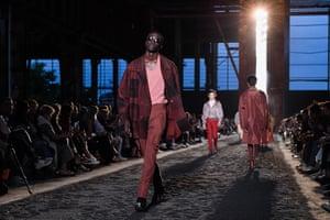 Models on Ermenegildo Zegna's wasteland catwalk