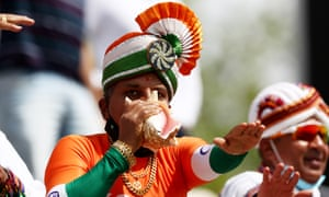 India cricket fan blows into a shell.