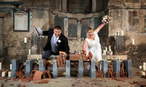 Having a smashing time: Chris and Lisa Pitman hold the record for breaking roof tiles.