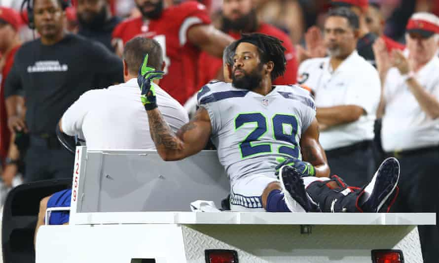 Earl Thomas  makes his feelings known as he is carted off the field