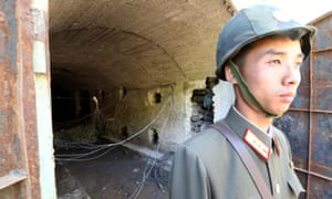 A North Korean soldier stands guard in front of the third tunnel of the Punggye-ri nuclear test site before it was blown up.
