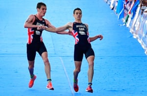 Helping hand: Alistair Brownlee helps brother Jonathan cross the line as he collapses from heat exhaustion 200m before the finish.