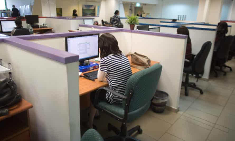 An office of people sitting at their desks