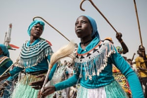 Members of a traditional music and dance group perform before a rally for supporters of Sudan's ruling Transitional Military Council in the village of Abraq.