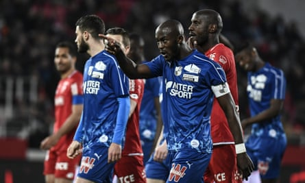 The Amiens captain Prince Gouano points out at the supporter he believes racially abused him during the Ligue 1 match at Dijon.