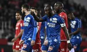 The Amiens captain Prince Gouano points to a Dijon supporter who racially abused him during a Ligue 1 match in April.