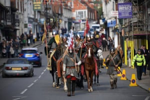 Historical re-enactors make their way through Battle at the end of a march from York ahead of a battle of Hastings re-enactment