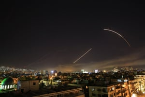 Missiles streak across the Damascus skyline as the US, alongside UK and French forces, launched air strikes aimed at reducing the Syrian regime's chemical weapons facilities.