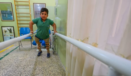 A boy tries out his prosthetic legs at the Red Cross (ICRC) physical rehabilitation clinic in Erbil, Kurdistan, northern Iraq.