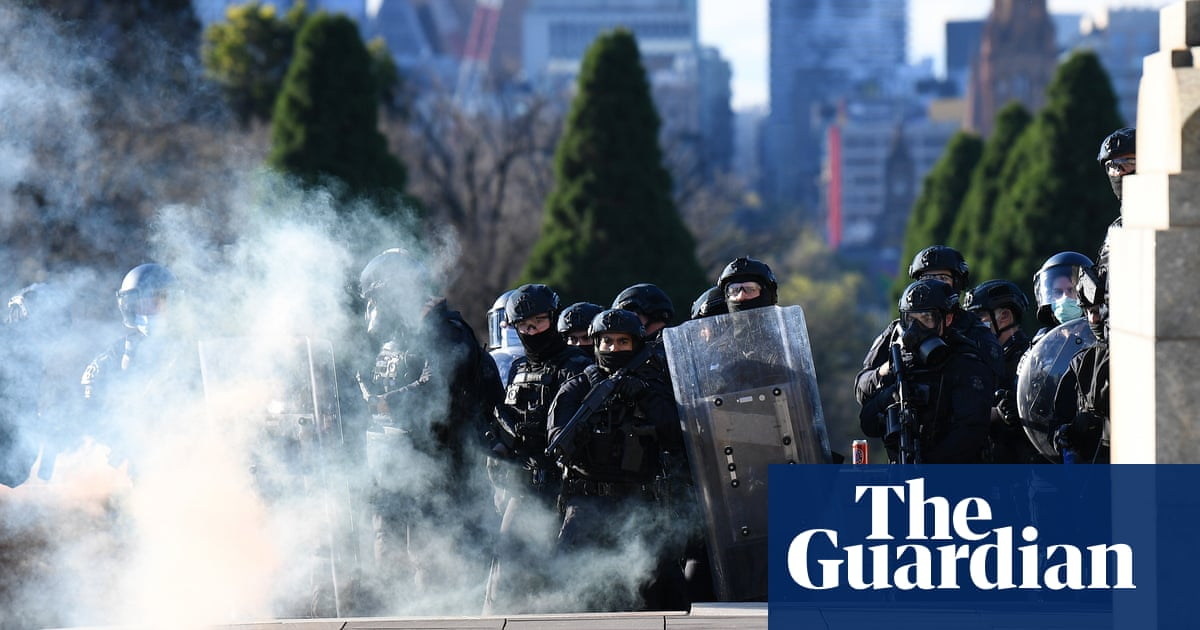 Melbourne police break up anti-lockdown protest with non-lethal rounds and teargas