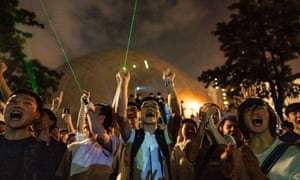 Protesters use laser pointers during a demonstration in Hong Kong.