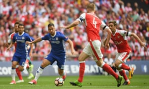 Eden Hazard of Chelsea takes on the Arsenal defence.