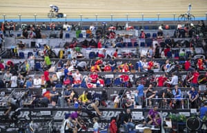 Athletes and their teams make preparations in the riders' area