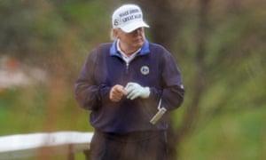 Donald Trump plays golf in Sterling, Virginia.