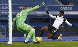 Fulham's Josh Maja, right, scores the opening goal.