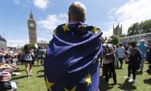 A protester wraps an EU flag around himself during an anti-Brexit march near the Houses of Parliament in London.