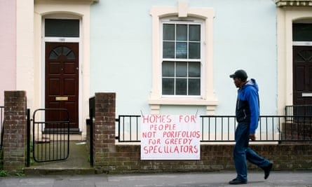 A man walks past a flat up for auction on City Road in St Paul's, Bristol.
