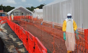 Health workers at an Ebola treatment centre run in Monrovia