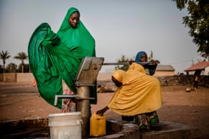 Women at a well in Nigeria