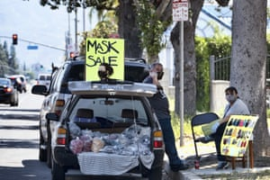 Vendors selling masks at the roadside in Los Angeles this week.