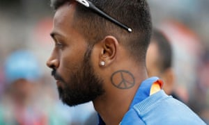 Indian all-rounder Hardik Pandya shows off his peace tattoo after the victory over Pakistan at Old Trafford.