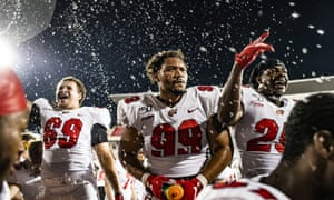 Western Kentucky's Devante Colton (69), Jalen Madden (99) and Bryson Washington (25) celebrate the team's win over UAB in an NCAA college football game last month.