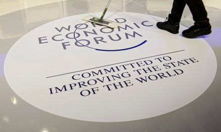 A worker cleans the WEF logo in Davos