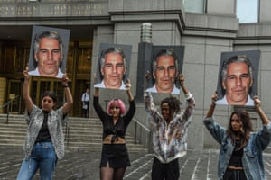 A protest group called Hot Mess hold up photos of Jeffrey Epstein in front of the Federal courthouse on 8 July 2019 in New York City.