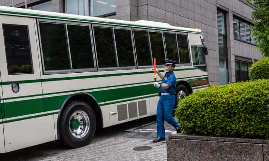 A transport vehicle arrives for the trial of Michael Taylor and his son, Peter, at the Tokyo district court on 14 June.