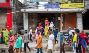 Garment workers with covered faces leaving work in Dhaka, Bangladesh