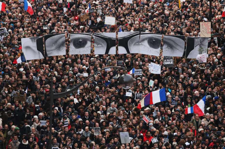 Demonstrators make their way along Boulevrd Voltaire in a unity rally in Paris following the Charlie Hebdo terrorist attacks on January 11, 2015 in Paris, France